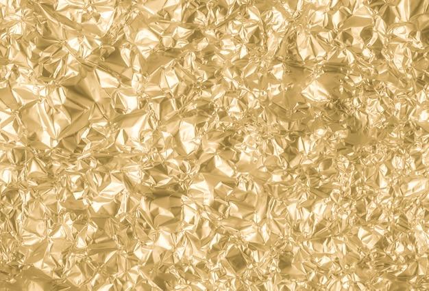 Fondo de papel arrugado oro del extracto de la textura
