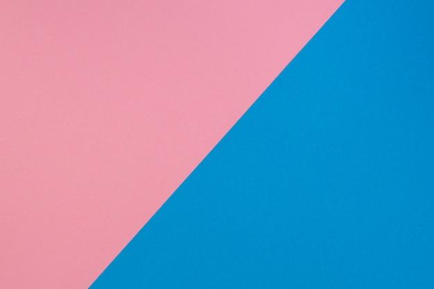 Fondo de papel de color dividido diagonal de dos tonos azul y rosa