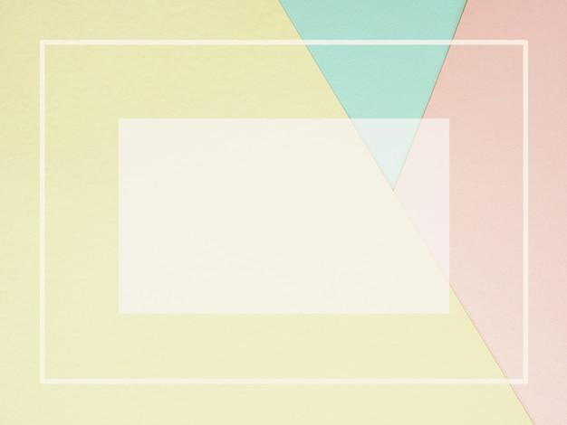 Fondo de papel de color geométrico abstracto en rosa pastel amarillo y azul con marco vacío