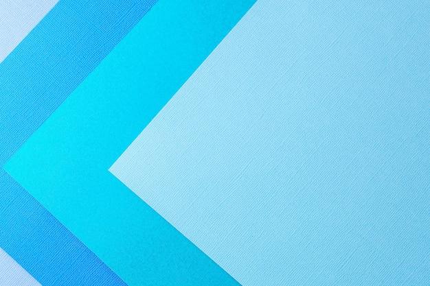 Fondo de papel de colores creativos en colores pastel, vista desde arriba.
