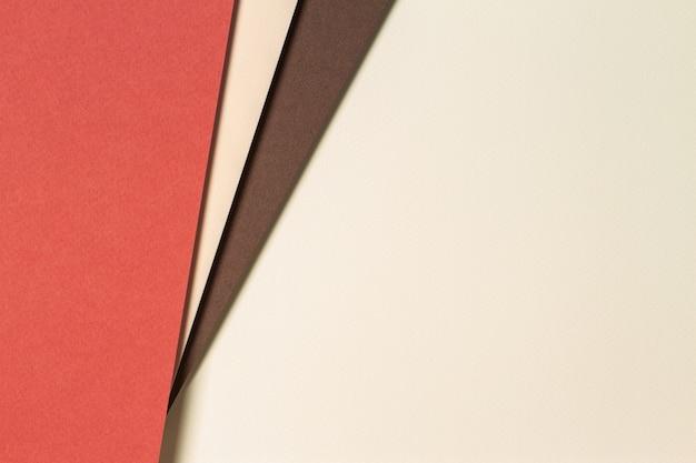 Fondo de papel geométrico abstracto en tonos tierra. fondo de colores beige, amarillo, marrón