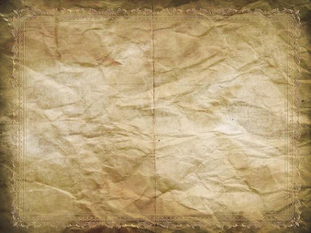Fondo de papel de grunge con un borde decorativo en relieve