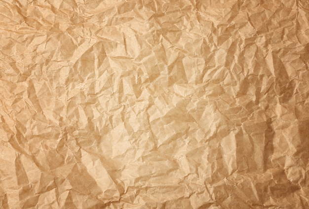 Fondo de papel de pergamino para hornear marrón arrugado