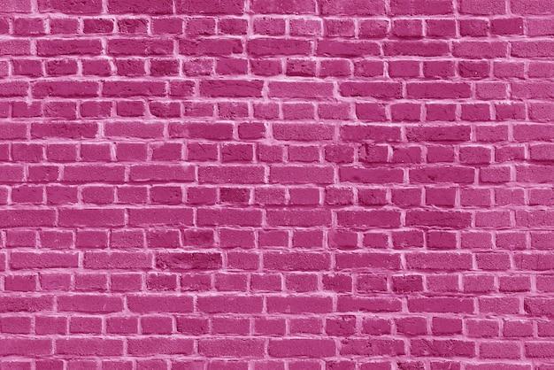 El fondo del papel pintado de la pared de ladrillo rosa viejo