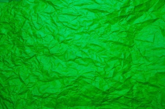 Fondo de papel verde con textura.