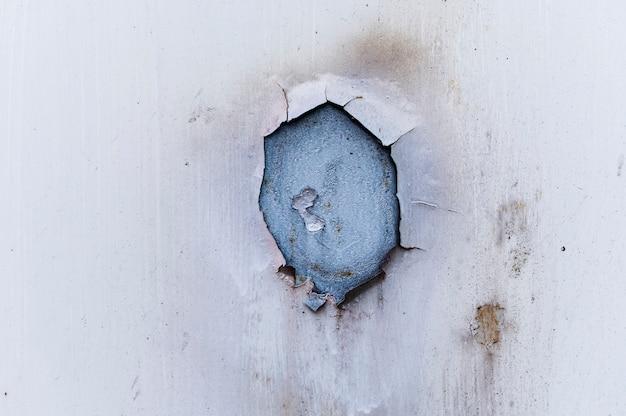 Fondo de pared blanca vieja y sucia