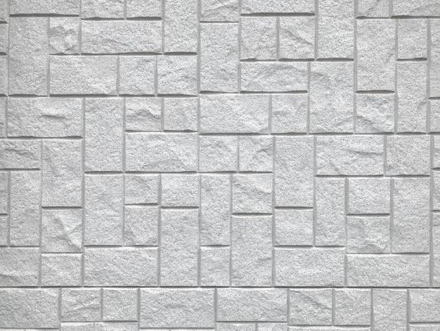 Fondo de pared de bloque de ladrillo cuadrado de piedra al azar.