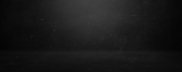 Fondo de pared de cemento gris y negro, sala en blanco