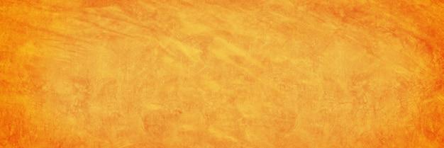 Fondo de pared de cemento de textura amarilla y naranja