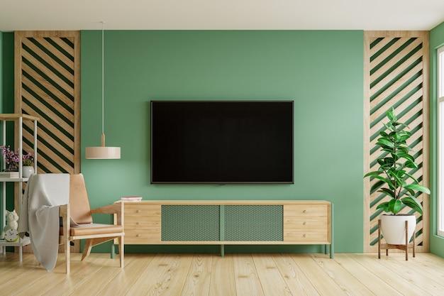 Fondo de pared de color verde, decoración moderna de la sala de estar con un mueble de televisión. representación 3d