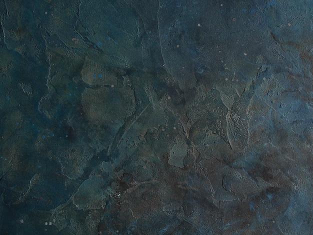 Fondo de pared de estuco decorativo abstracto azul oscuro gris grunge. textura sombría de frotis ásperos.