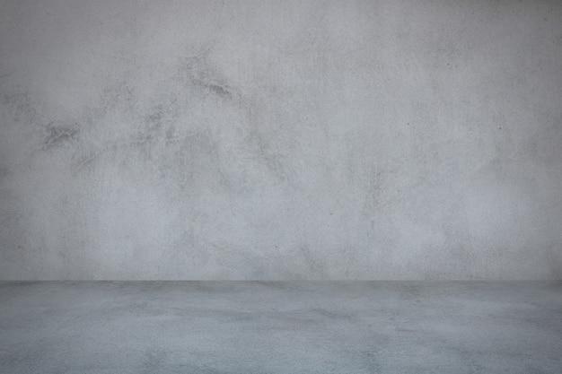 Fondo de pared de estudio y pared de cemento gris