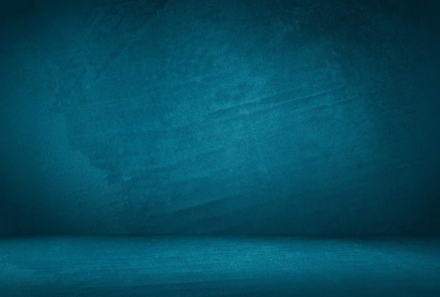 Fondo de pared de estudio de textura de hormigón azul grunge vintage con viñeta.