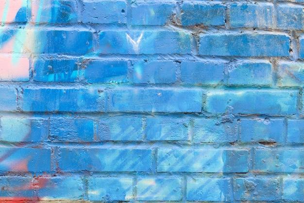 Fondo de pared de ladrillo pintado de azul