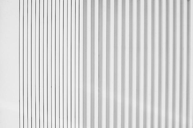 Fondo de pared de líneas geométricas de metal blanco