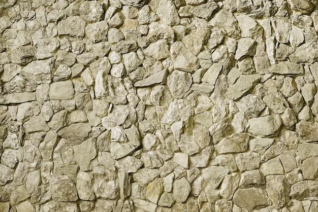 Fondo de pared de piedra beige moderno