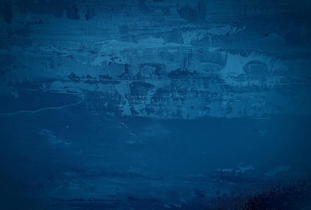Fondo de pared de textura de hormigón azul grunge vintage con viñeta.