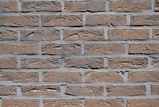Fondo de pared de textura de nuevos ladrillos de color marrón.