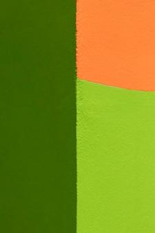 Fondo de pared verde y naranja