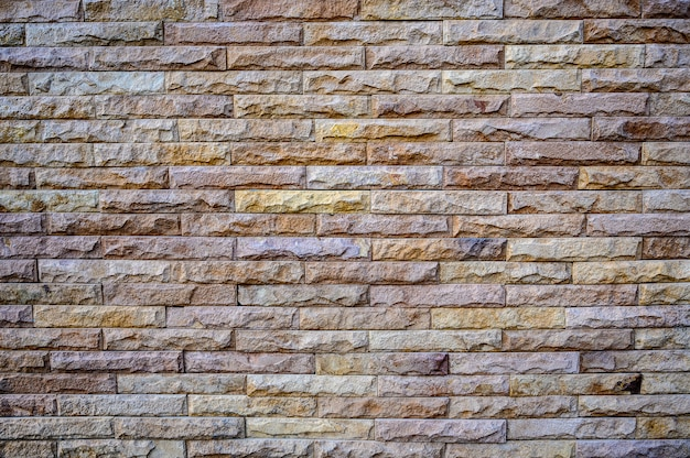 Fondo de patrón de pared de ladrillos de piedra marrón antiguo de pared de ladrillo