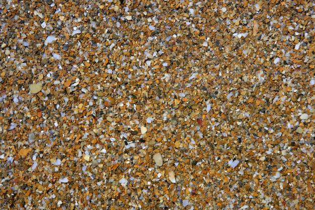 Fondo de patrón de piedras mojadas costa
