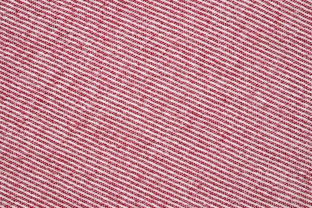 Fondo de patrón de textura de tela de ropa de raya roja y blanca abstracta