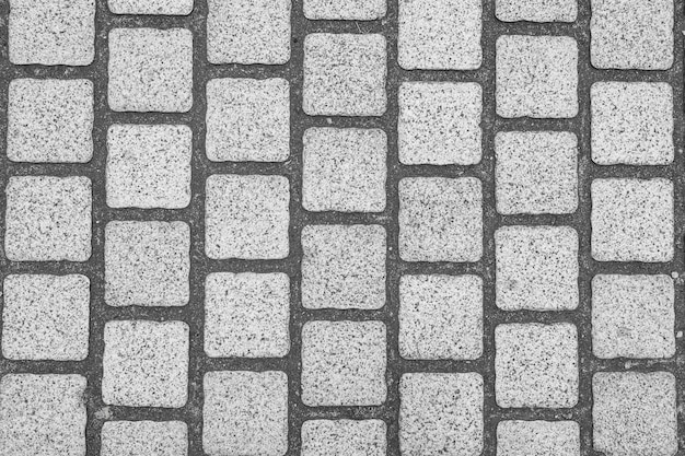 Fondo de pavimento de adoquines de granito.