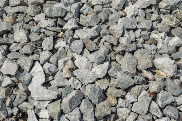 Fondo de piedra de granito triturado, textura de roca.