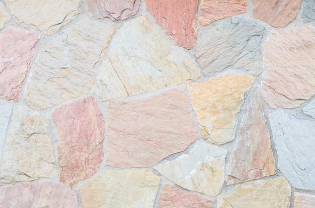 Fondo de piedra hermoso de la textura de la pared de ladrillos del primer