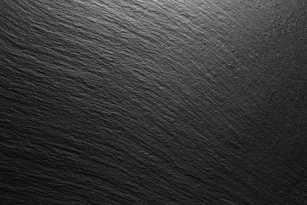 Fondo de pizarra negra con textura con punto de luz