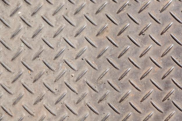 Fondo de placa de diamante de metal en color marrón