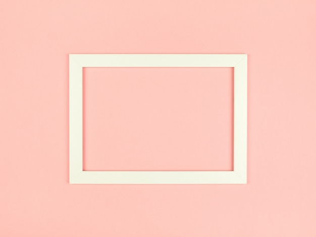 Fondo plano de color pastel con marco de imagen vacío
