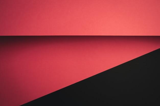 Fondo plano de color rosa y negro vivo con capas nítidas y sombras con espacio de copia