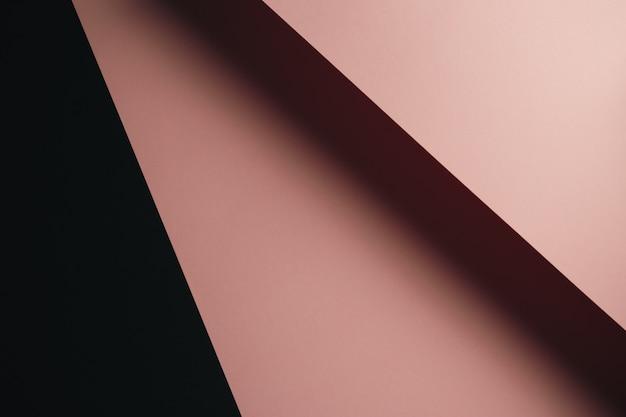Fondo plano de color rosa pastel y negro con capas nítidas y sombras con espacio de copia