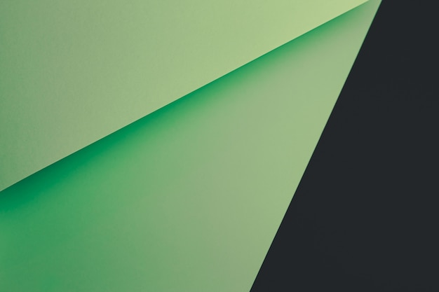 Fondo plano verde pastel y negro con capas nítidas y sombras con espacio de copia
