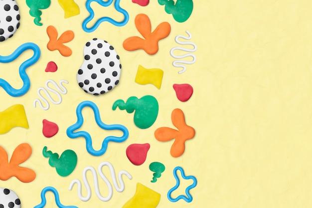 Fondo de plastilina con dibujos de arcilla en borde amarillo colorido arte creativo de bricolaje para niños