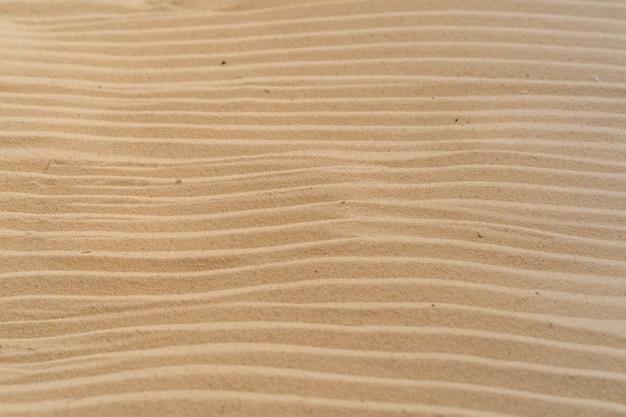Fondo de playa de arena y patrón de textura con espacio.
