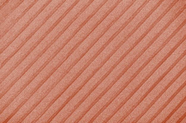 Fondo plisado en tonos marrones. líneas geométricas de tela. tela, textil de cerca.