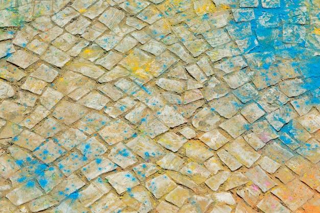 Fondo de polvo coloreado en el suelo