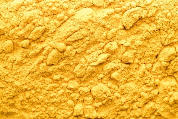 Fondo de polvo de comida amarilla orgánica