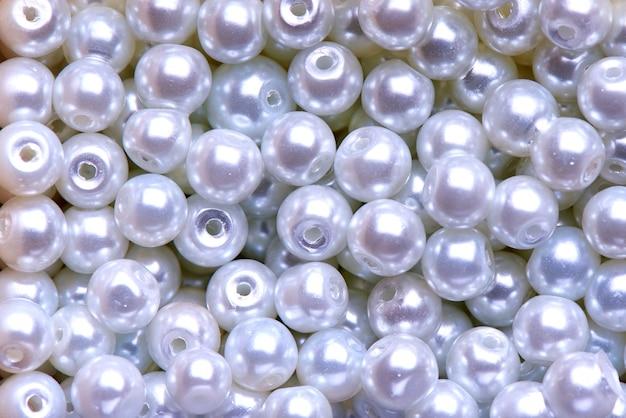 Fondo del primer decorativo blanco de las perlas concepto de la textura y del fondo.