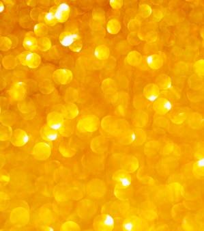 Fondo de primer plano de brillo dorado desenfocado
