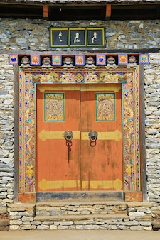 Fondo de puerta de piedra de arte de bután, viaje de país de asia