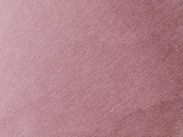 Fondo purpúreo claro de la textura de la alfombra de la pendiente.