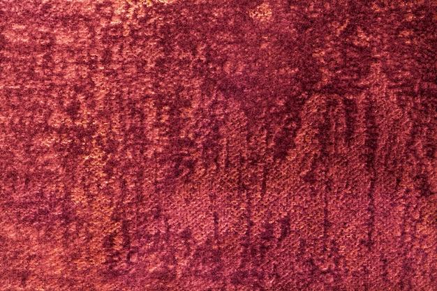 Fondo rojo oscuro esponjoso de tela suave y vellosa. textura de textil terciopelo vino