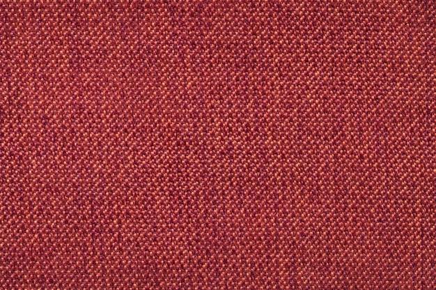 Fondo rojo de la textura de lana textil, primer plano. estructura de la macro de tela de mimbre.