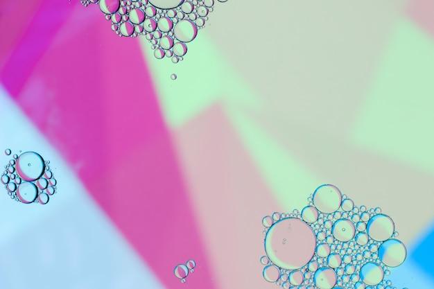 Fondo rosado abstracto de las sombras del aceite