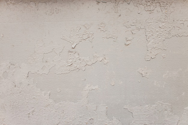Fondo simple del muro de cemento con blanco de la textura.
