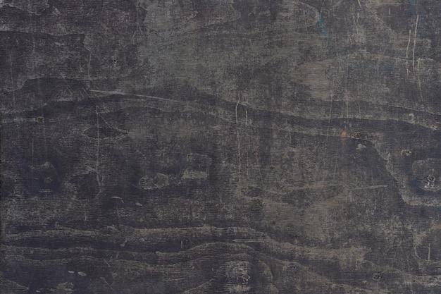 Fondo de suelo de madera contrachapada negro