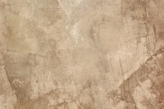 Fondo y superficie de enlucido de cemento.